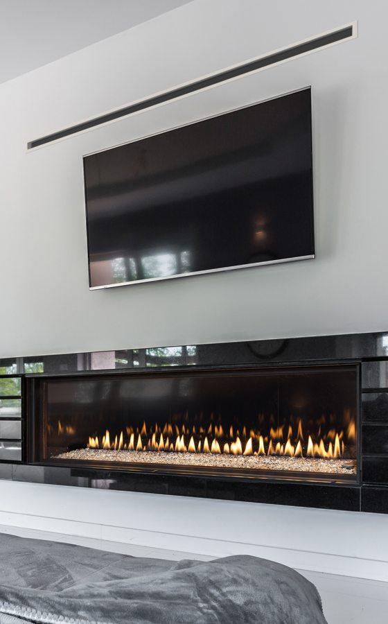 living room fireplace in a modern saskatoon home